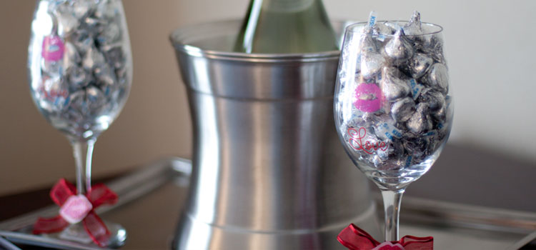 Kissable Package with 2 wine glasses filled with Hershey kisses.