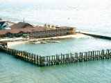 Directly on the bay and inlet with a large fishing pier and jet skis.