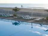 Boardwalk hotel with two outdoor pools.