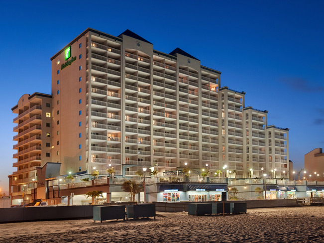 Hotel exterior and boardwalk from the beach at night