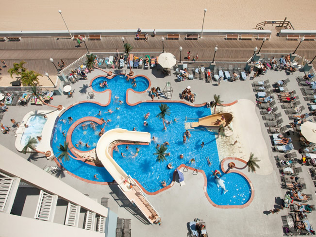 Aerial view of waterpark features, pool, and lounging areas