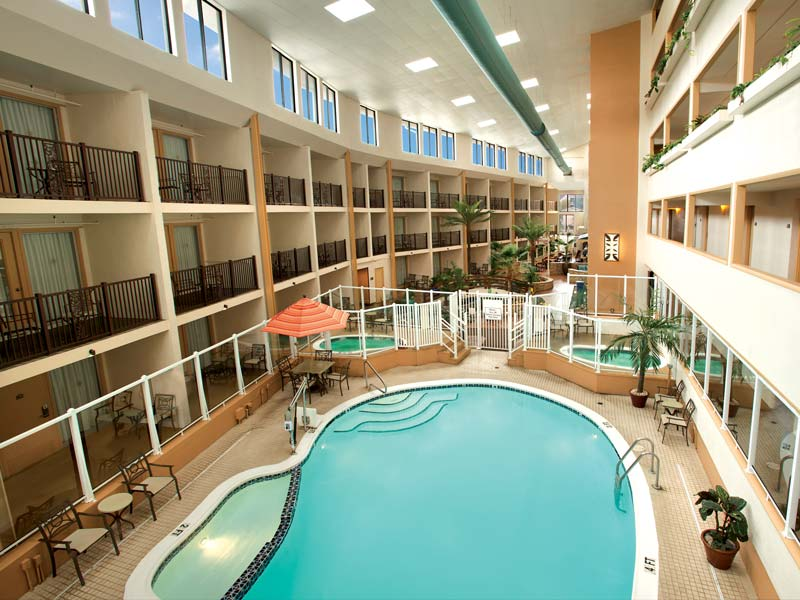 Heated indoor pool and hot tub in tropical atrium