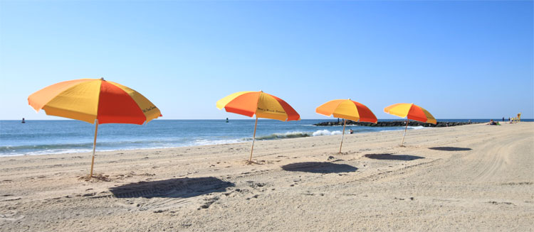 Umbrellas on a hot beach waiting for you…