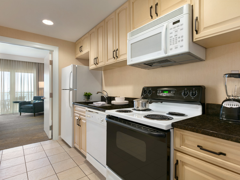 Fully equipped kitchen with complete with full stove and dishwasher