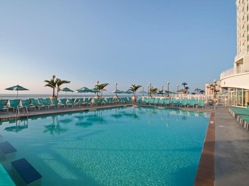 Oceanfront adult pool with sweeping panoramic view and clear skies