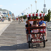 Rent a surry and enjoy a morning bike ride on the world famous ocean city boardwalk with the family.