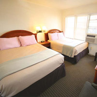 Our Inlet Suite room comes with 2 cozy double beds so you can sleep comfortably after a fun day in Ocean City.