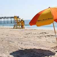 Rent a beach umbrella and sit back letting all your worries fade away.