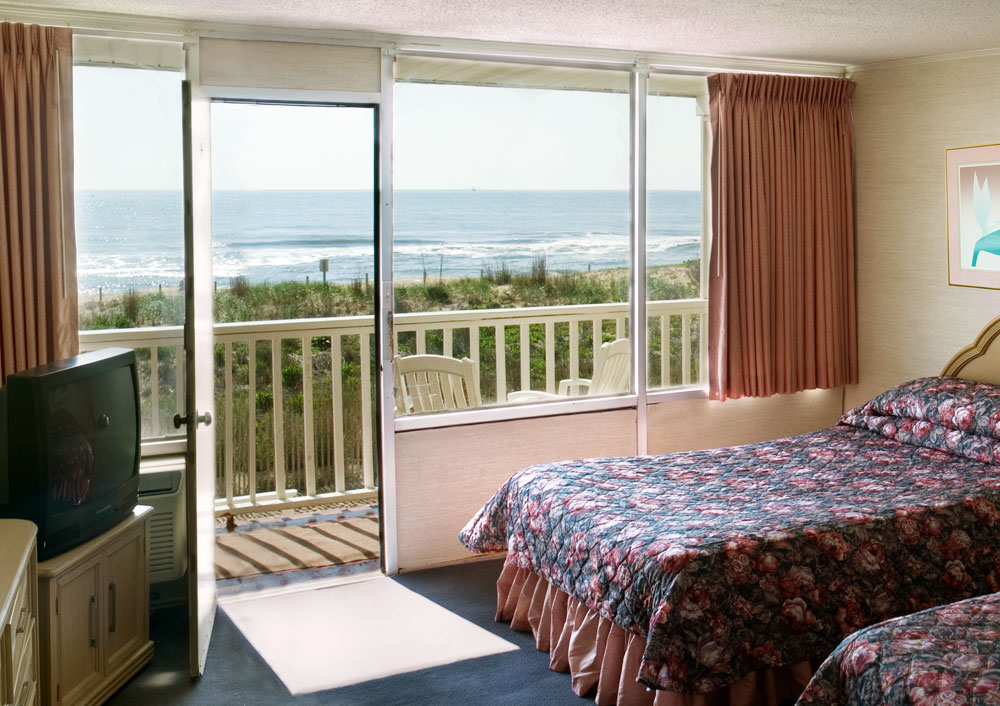 Our oceanfront room has large windows overlooking the beach.