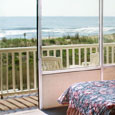 The oceanfront room has Large glass windows and a porch where you can sit and see the ocean and beach.