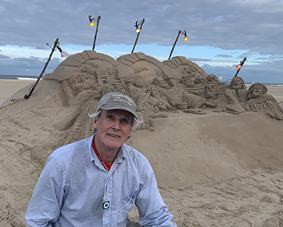right photo Randy Hofman with sand sculpture