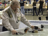 Judging the floating decoys at the Wild Fowl Competition in Ocean City,