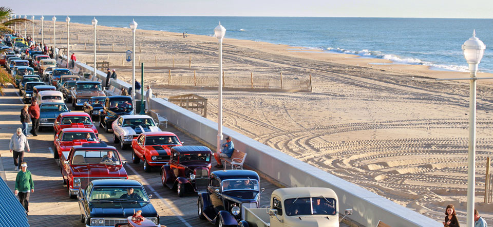 Classic cruiser cars line the Ocean City Boardwalk for the annual parade.