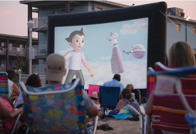 As the evening sun sets enjoy the sounds of the beach while a movie plays on a large screen for families to enjoy.